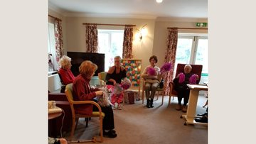 Pom pom dancing at Evercreech care home